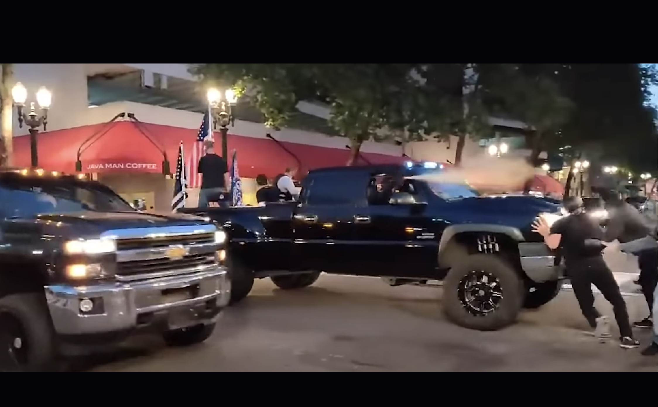 [VIDEO] Scrawny Antifa Protesters vs Huge Trump Truck.....Any Bets on Who Wins?