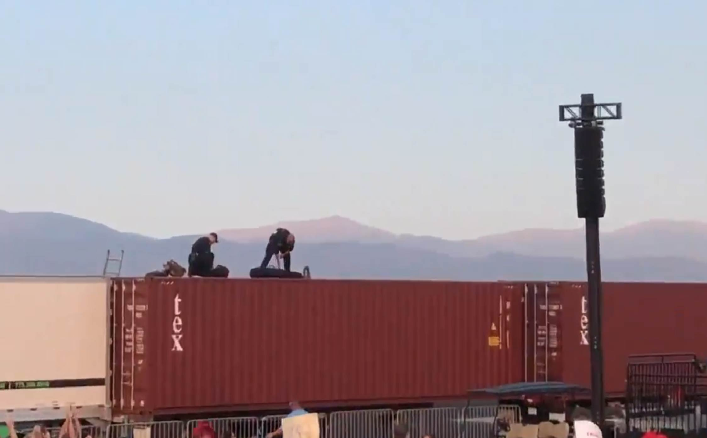 [VIDEO] Crowd Erupts as Snipers Take Their Position on Semi-Trucks at Trump's Rally