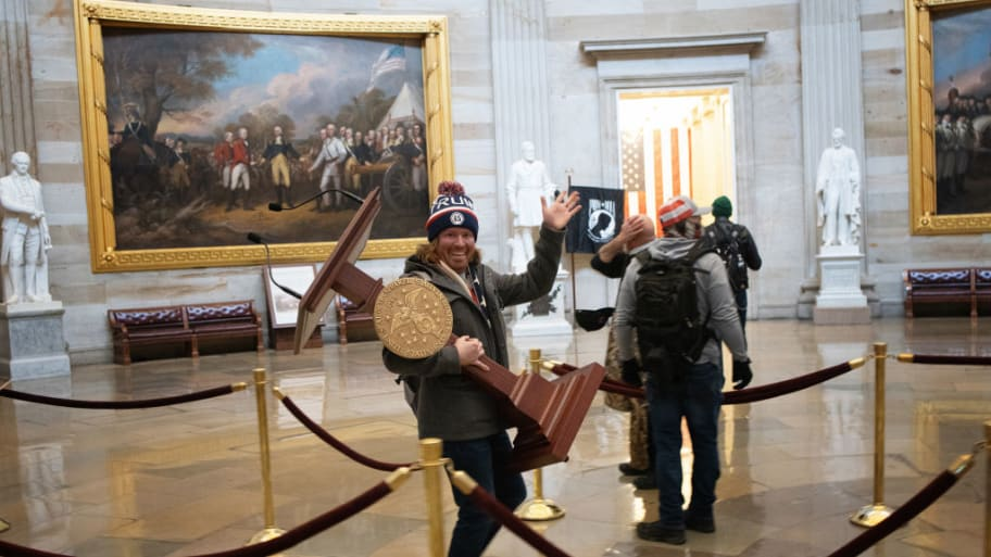 Man Seen In Viral Photo Carrying Pelosi's Podium Is Arrested