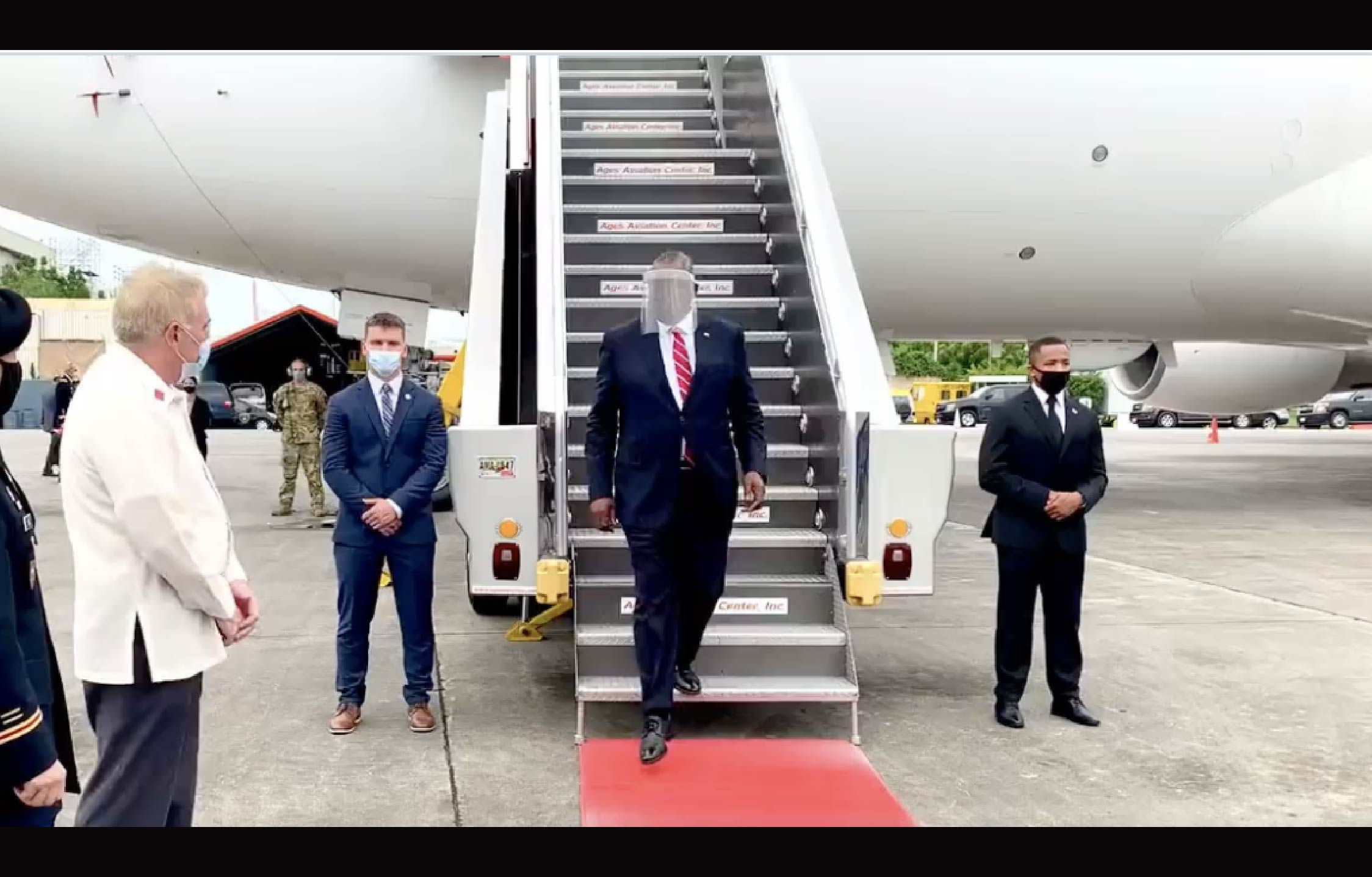 [VIDEO] Biden's Secretary of Defense Confuses Many With His Getup As He Disembarks in the Philippines