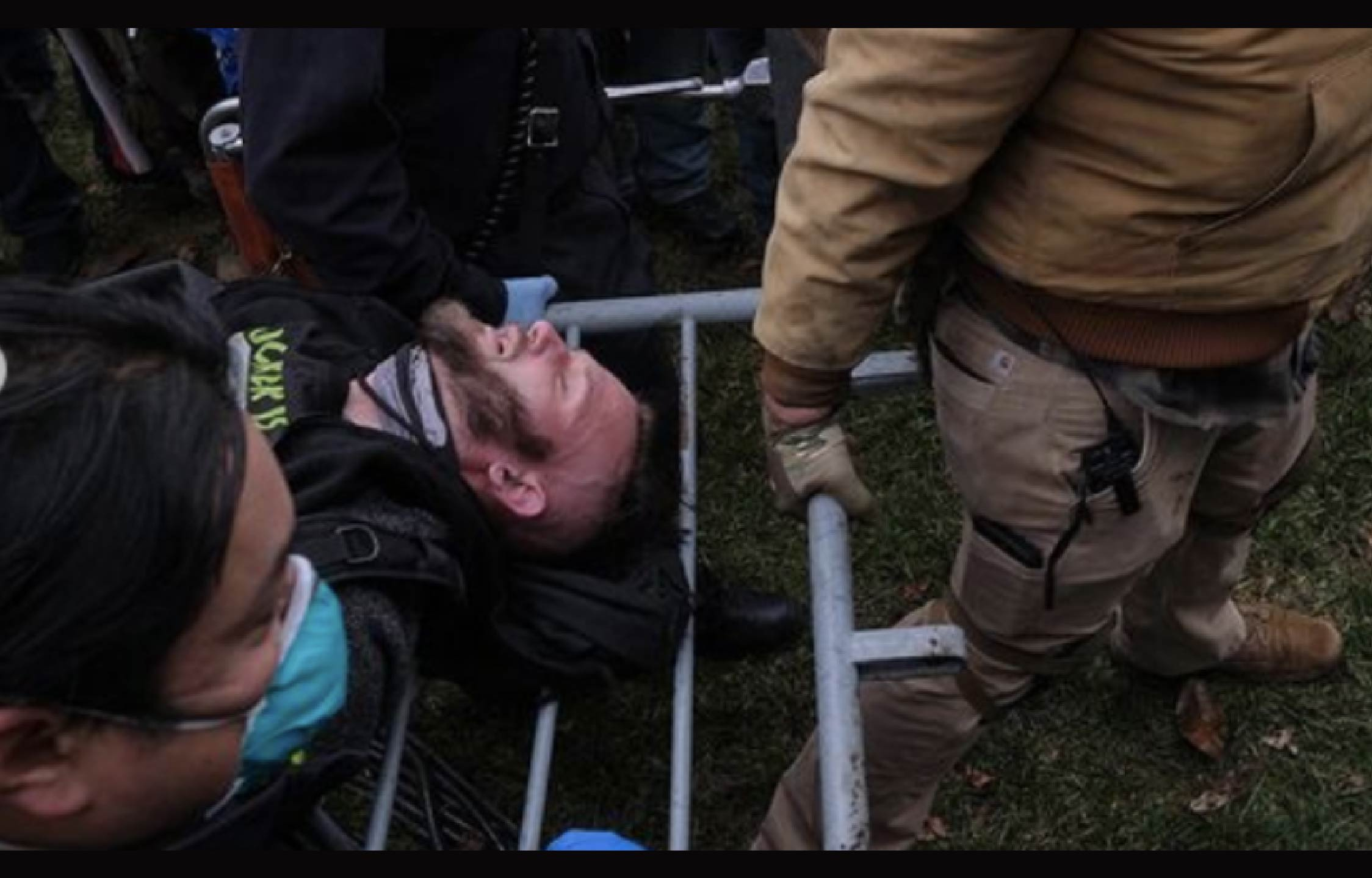 [VIDEO] Trump Supporters Examine New Jan 6 Clip and Have a Theory About Injured Man We've Never Seen Before
